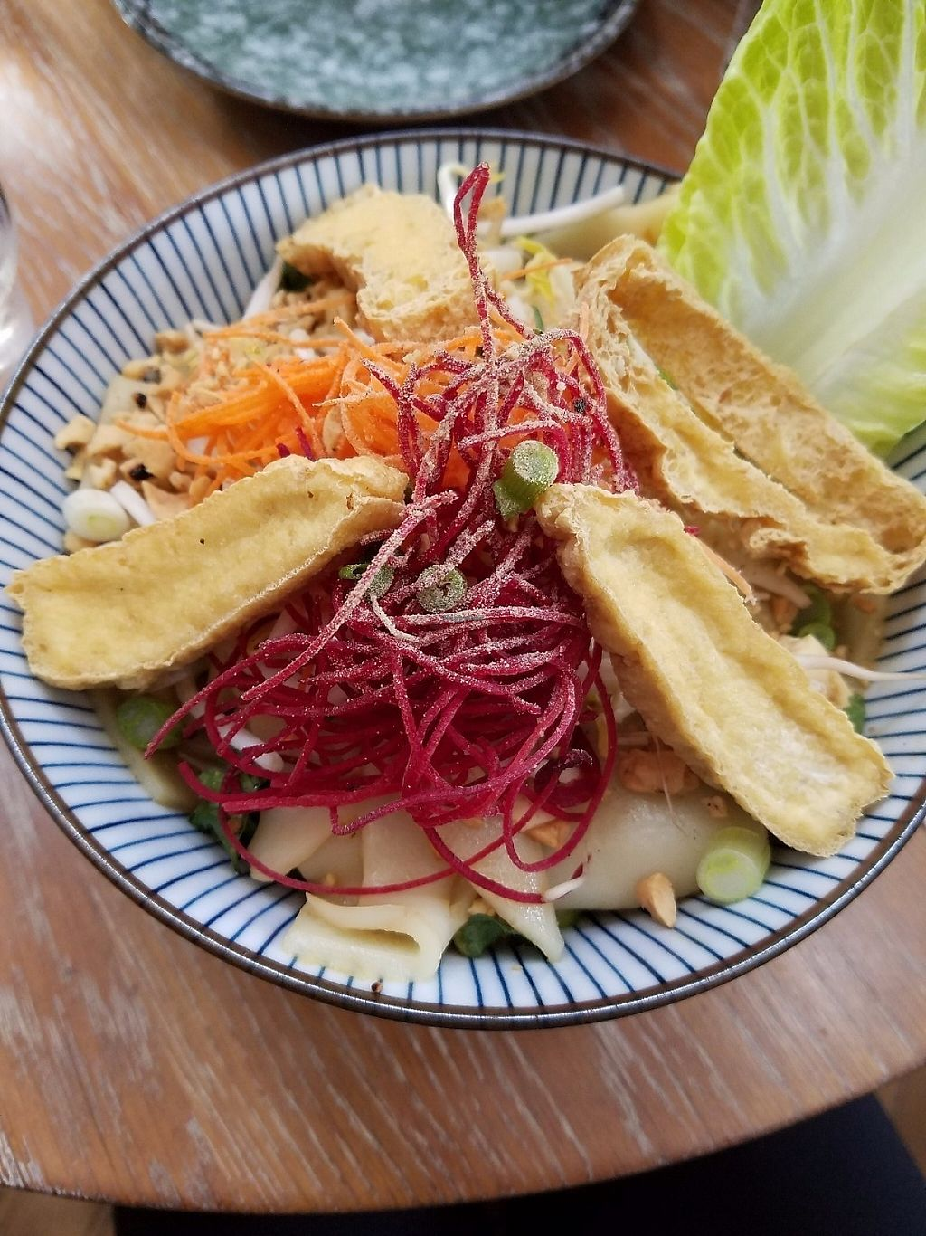 """Photo of DC Noodles  by <a href=""""/members/profile/MerryRose"""">MerryRose</a> <br/>Noodle salad with wide rice noodles, bean sprouts, carrot, beetroot, romaine, peanuts, a sweet (vegan) sauce, as well as both crispy and regular firm tofu <br/> May 11, 2017  - <a href='/contact/abuse/image/92005/257893'>Report</a>"""