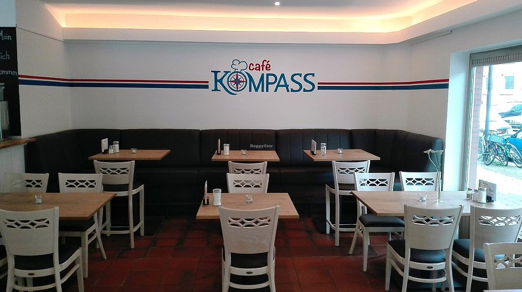 """Photo of Cafe Kompass  by <a href=""""/members/profile/kilianr"""">kilianr</a> <br/>furniture with logo <br/> May 18, 2017  - <a href='/contact/abuse/image/92246/259944'>Report</a>"""