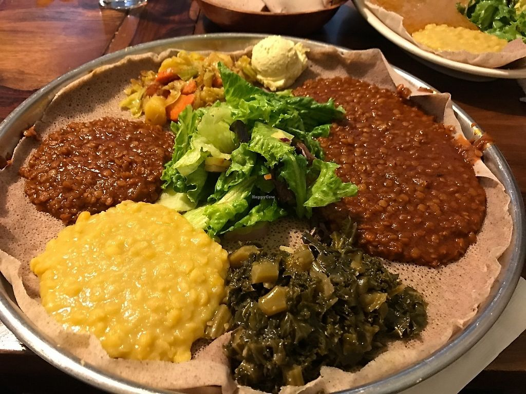 "Photo of Enssaro Ethiopian Restaurant  by <a href=""/members/profile/Tigra220"">Tigra220</a> <br/>Veggie Platter with a scoop of hummus <br/> May 19, 2017  - <a href='/contact/abuse/image/92389/260271'>Report</a>"