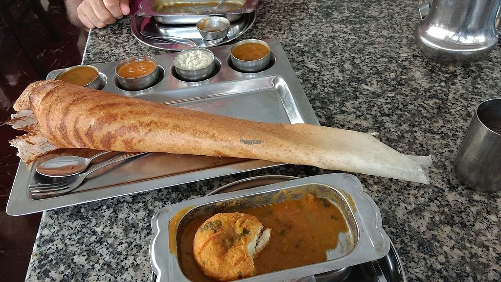 """Photo of Annapoorna Restaurant  by <a href=""""/members/profile/Berylvt"""">Berylvt</a> <br/>Paper dosa (made with rice flour). Very thin and crispy with 4 different dipping sauces. The white sauce was coconut based <br/> March 5, 2017  - <a href='/contact/abuse/image/9252/232884'>Report</a>"""