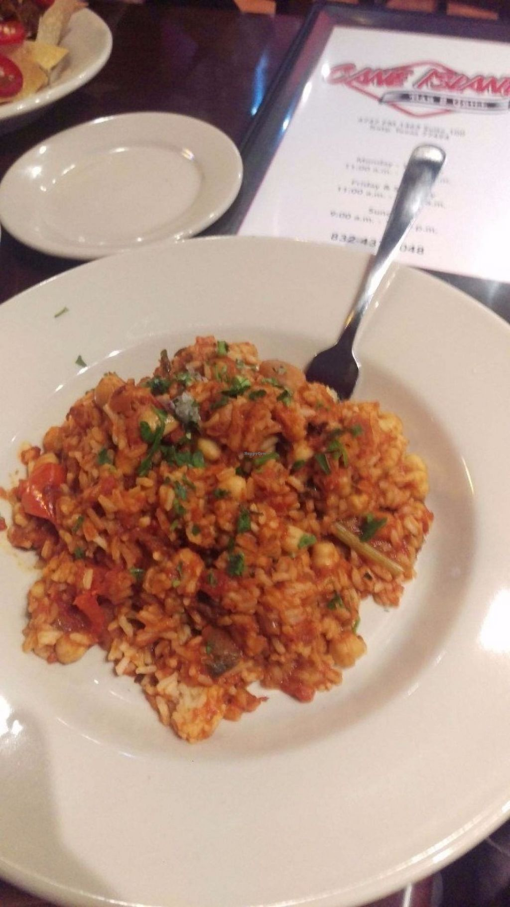 "Photo of Cane Island Bar & Grill  by <a href=""/members/profile/hrdial"">hrdial</a> <br/>Vegan jambalaya <br/> May 20, 2017  - <a href='/contact/abuse/image/92534/260716'>Report</a>"