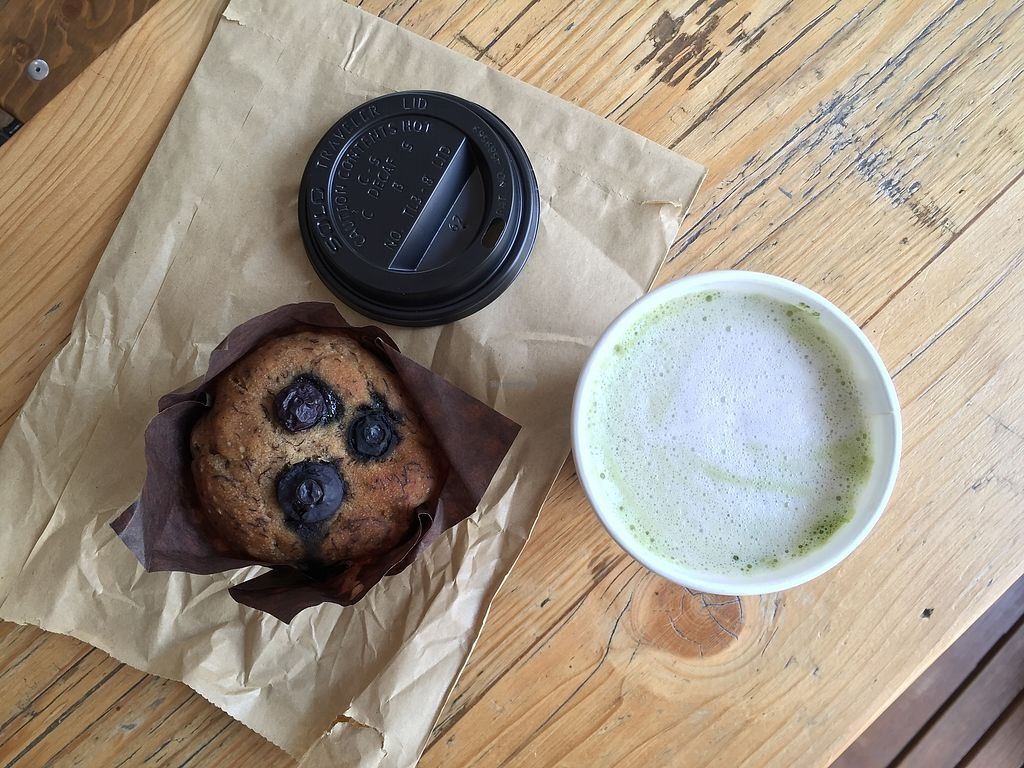 """Photo of Roots Juicery  by <a href=""""/members/profile/SimonaEi"""">SimonaEi</a> <br/>Vegan GF blueberry muffin with almond matcha latte  <br/> August 7, 2017  - <a href='/contact/abuse/image/92666/290082'>Report</a>"""