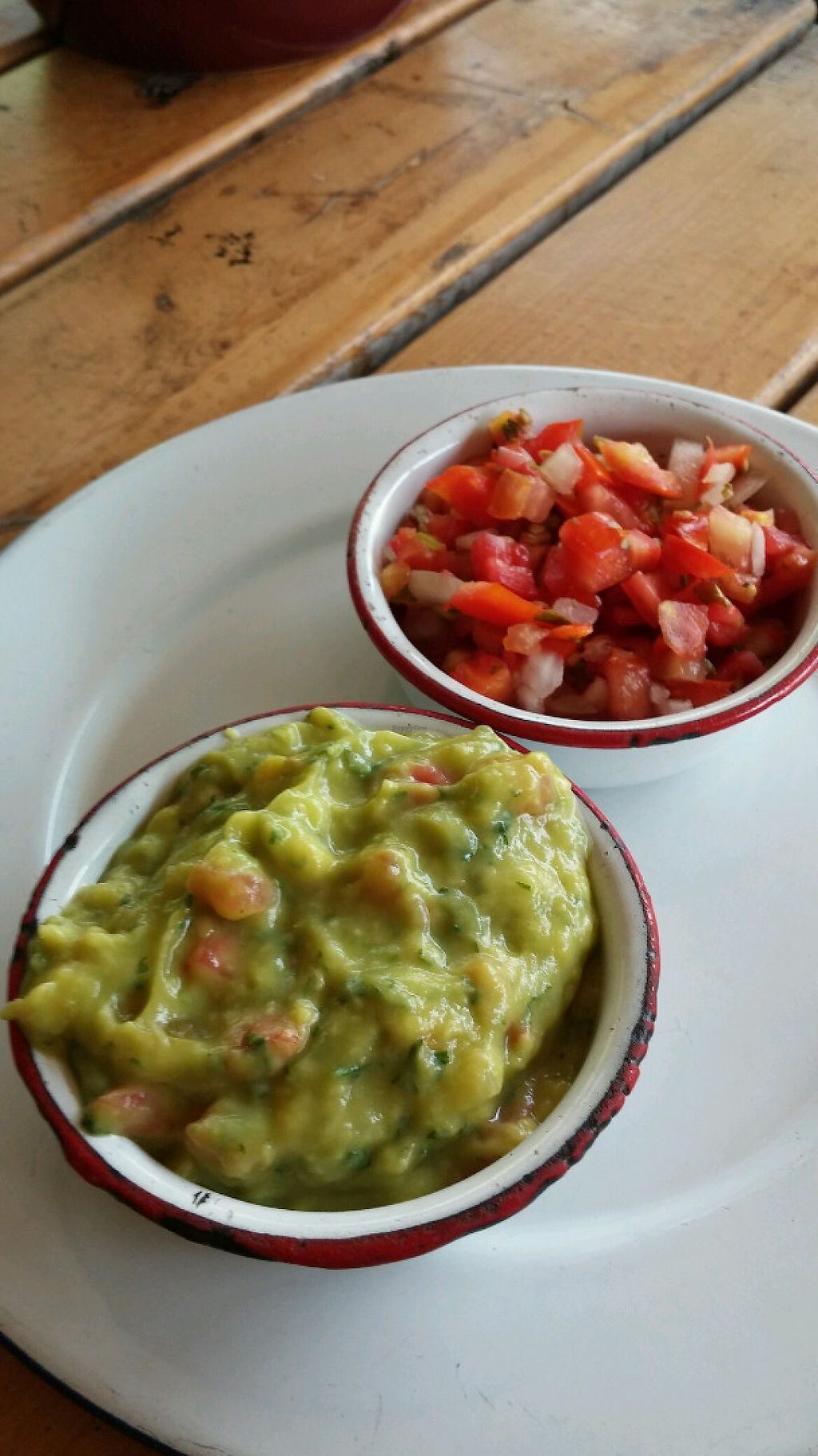 "Photo of Wacamole  by <a href=""/members/profile/jasminebagha"">jasminebagha</a> <br/>Chips come with guacamole, tomatoes, a small bowl of beans and 2 different hot sauces <br/> May 26, 2017  - <a href='/contact/abuse/image/92791/262696'>Report</a>"