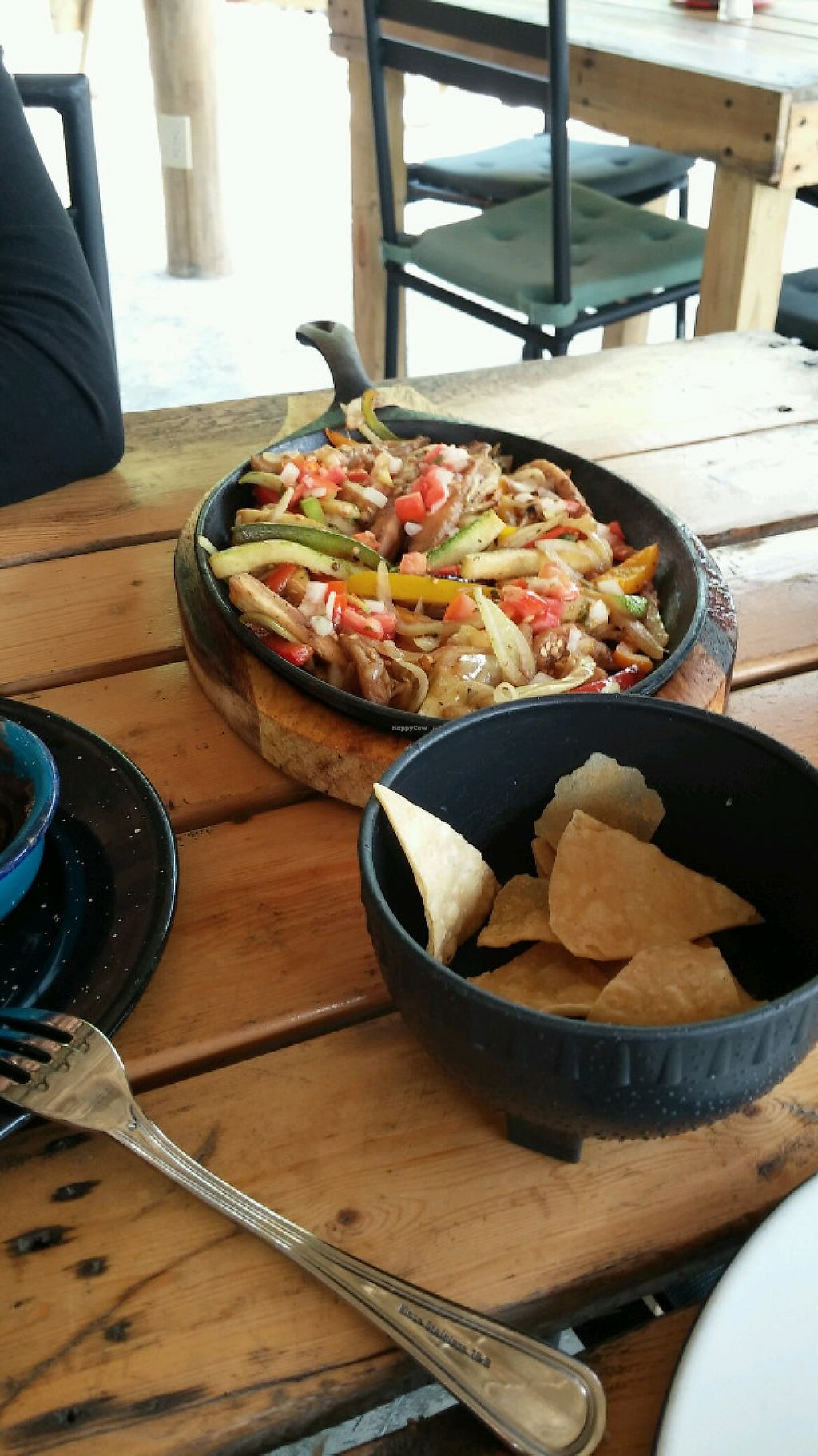 "Photo of Wacamole  by <a href=""/members/profile/jasminebagha"">jasminebagha</a> <br/>If you order the fajitas, you get 5 corn tortillas and the vegetables (onions, bell pepper, zucchini, eggplant) come on a sizzling skillet.  <br/> May 26, 2017  - <a href='/contact/abuse/image/92791/262699'>Report</a>"