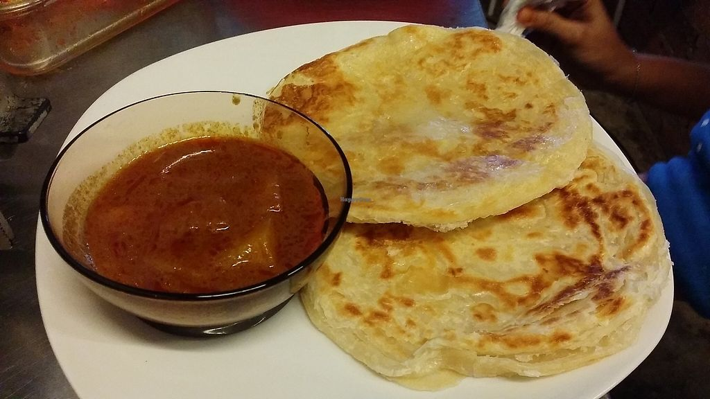 "Photo of Indah Cafe  by <a href=""/members/profile/IndahHouseKuching"">IndahHouseKuching</a> <br/>Roti canai/praha with curry <br/> May 30, 2017  - <a href='/contact/abuse/image/92925/264084'>Report</a>"
