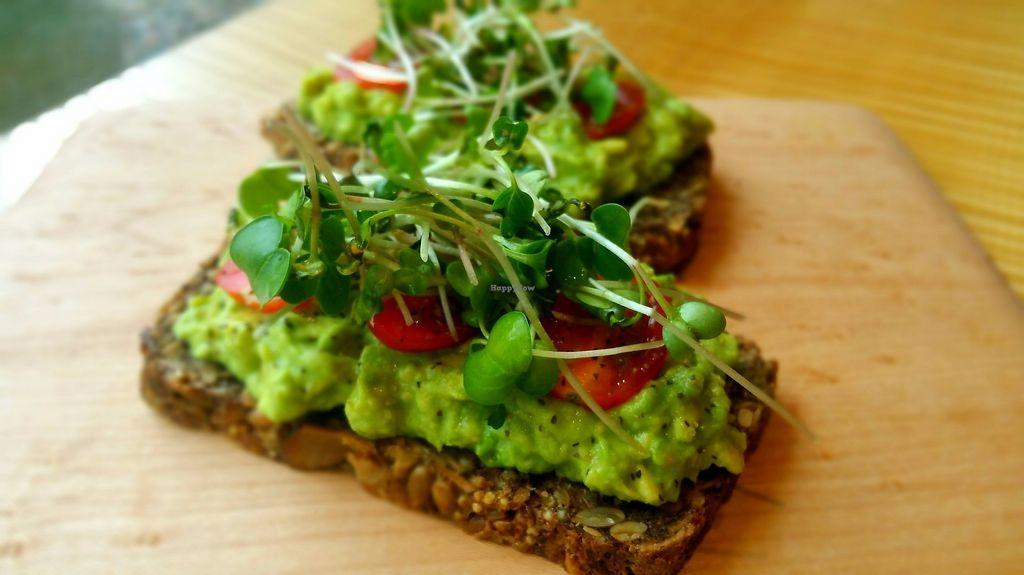 "Photo of Surya Cafe  by <a href=""/members/profile/LaurenM"">LaurenM</a> <br/>Meg's toast: House-made gf seed and nut bread topped with avocado, lemon juice, tomato, home-grown sprouts, salt and pepper <br/> June 8, 2017  - <a href='/contact/abuse/image/92932/266814'>Report</a>"
