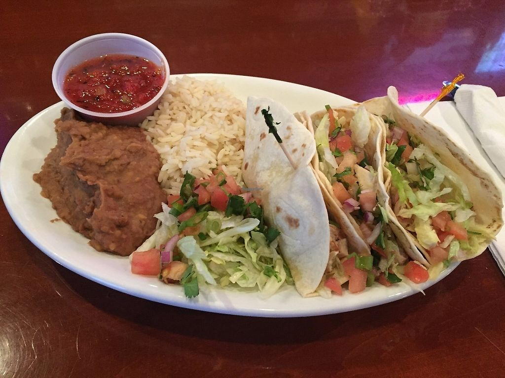 Photo of Legacy Pub  by sst <br/>Tippe Tacos:  3 soft tacos filled with Gardein Chick'n, lettuce & pico served with fire roasted salsa, white rice & refried beans. (vegan) <br/> May 30, 2017  - <a href='/contact/abuse/image/92959/264347'>Report</a>