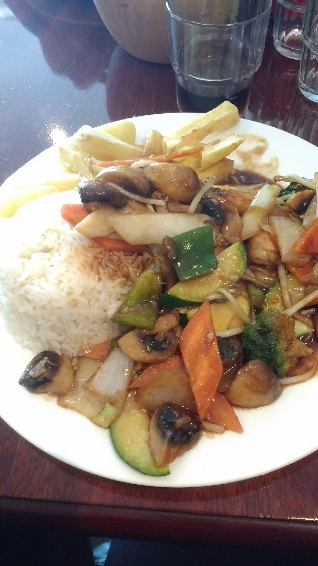 "Photo of Lotus  by <a href=""/members/profile/ArySimieli"">ArySimieli</a> <br/>Stir-fry with rice/chips and vegetables, with a mushroom sauce <br/> May 29, 2017  - <a href='/contact/abuse/image/93011/263733'>Report</a>"
