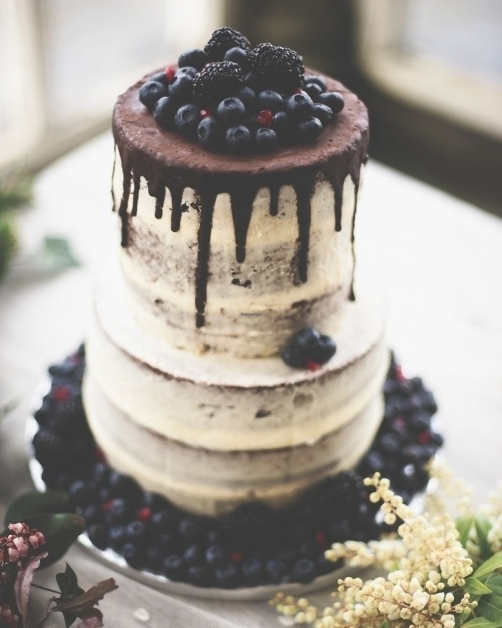 """Photo of Miam Vegan Bakery  by <a href=""""/members/profile/Whazy88"""">Whazy88</a> <br/>chocolate and vanilla naked wedding cake with berries <br/> June 3, 2017  - <a href='/contact/abuse/image/93307/265311'>Report</a>"""