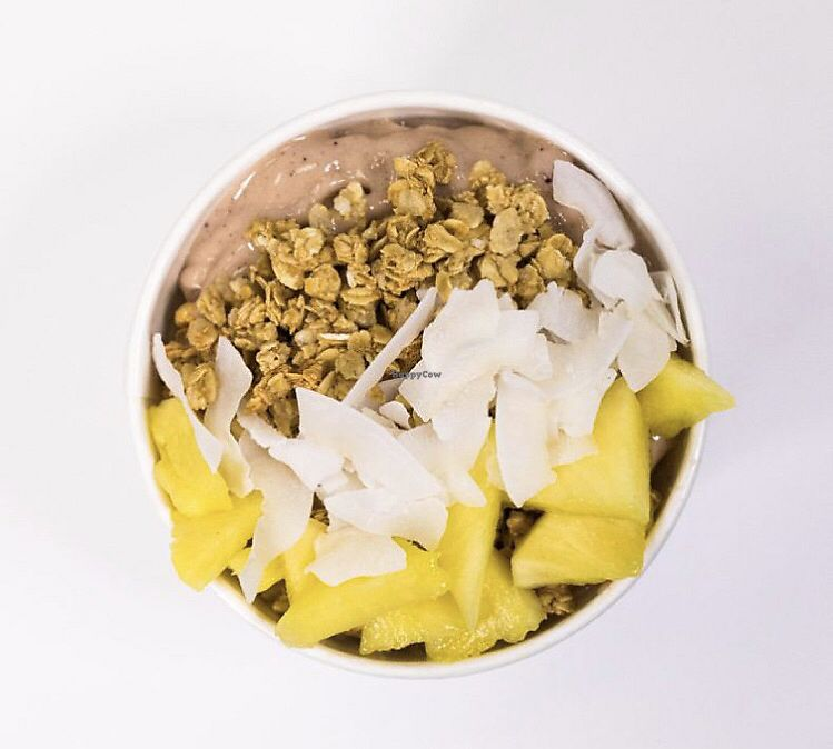 """Photo of Clean Juice  by <a href=""""/members/profile/RachelZima"""">RachelZima</a> <br/>Beach bowl! Banana, pineapple, coconut oil, açaí, almond milk topped with granola, pineapple and coconut flakes! <br/> March 31, 2018  - <a href='/contact/abuse/image/93504/378837'>Report</a>"""