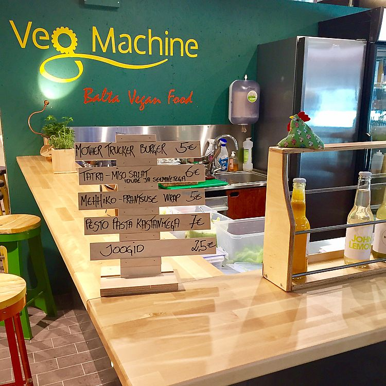 "Photo of Veg Machine  by <a href=""/members/profile/Morbid%20Cafe"">Morbid Cafe</a> <br/>Seating stools and menu <br/> June 9, 2017  - <a href='/contact/abuse/image/93672/267296'>Report</a>"