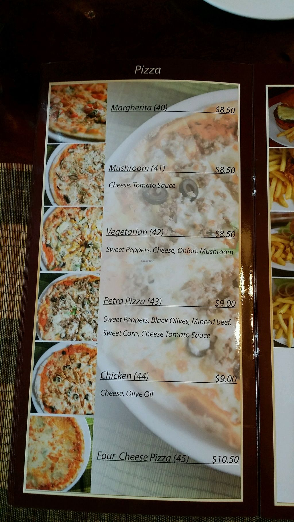 """Photo of Petra Restaurant  by <a href=""""/members/profile/Mike%20Munsie"""">Mike Munsie</a> <br/>pizza menu <br/> September 9, 2017  - <a href='/contact/abuse/image/93857/302454'>Report</a>"""