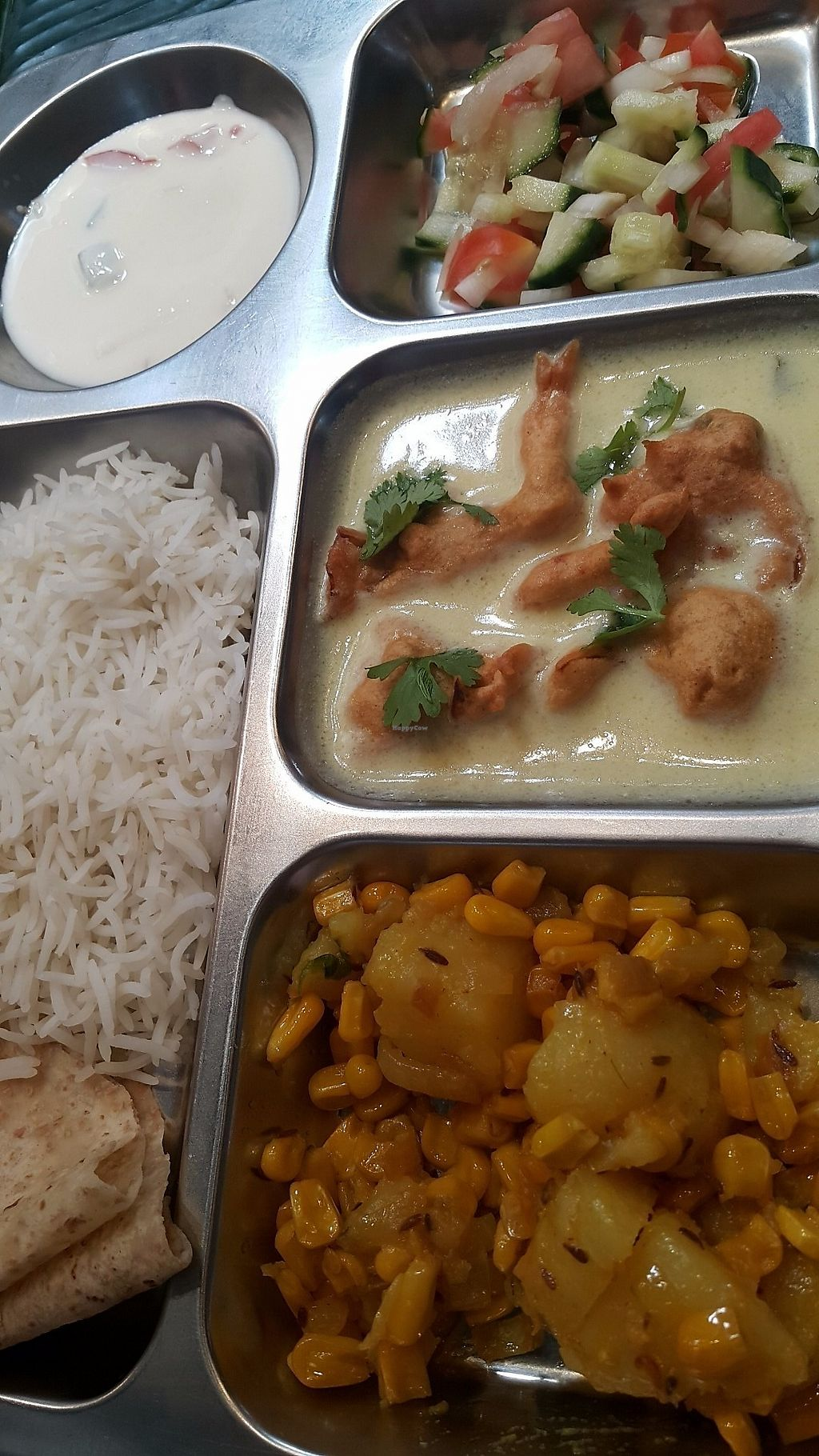 "Photo of Simply India  by <a href=""/members/profile/NeeleshBhagattjee"">NeeleshBhagattjee</a> <br/>veg thali : fresh vegetables potato & corn; khadhi & pakoda ( spicy mint yogurt with onion rings fried in gram flour ) basmati rice; raita; sambals <br/> June 15, 2017  - <a href='/contact/abuse/image/94093/269540'>Report</a>"
