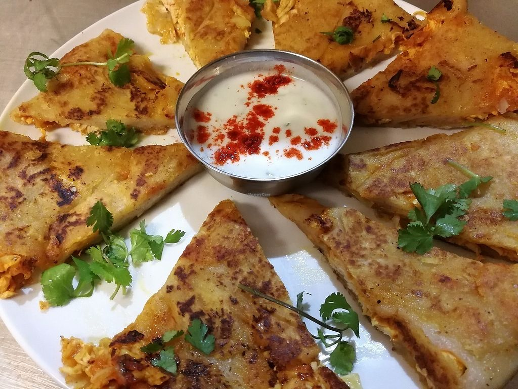 "Photo of Simply India  by <a href=""/members/profile/NeeleshBhagattjee"">NeeleshBhagattjee</a> <br/>veg paratha : a indian bread with potato & chickpea filling between the layers of the rotli, its pan fried to perfection on a hot tavi <br/> June 15, 2017  - <a href='/contact/abuse/image/94093/269541'>Report</a>"