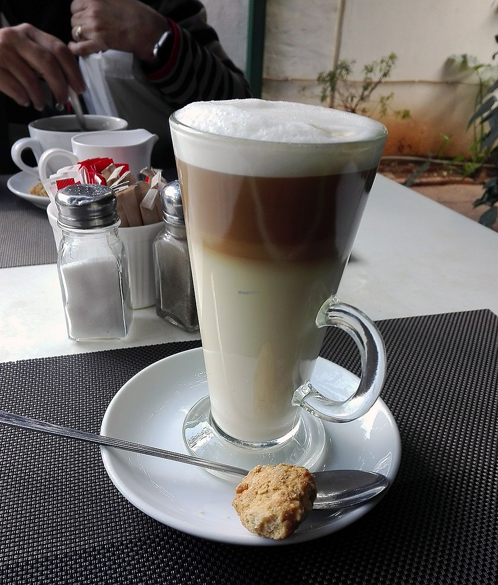 "Photo of The Secret Garden  by <a href=""/members/profile/NatashaV"">NatashaV</a> <br/>Soy milk latte with vegan biscuit <br/> January 2, 2018  - <a href='/contact/abuse/image/94231/342029'>Report</a>"