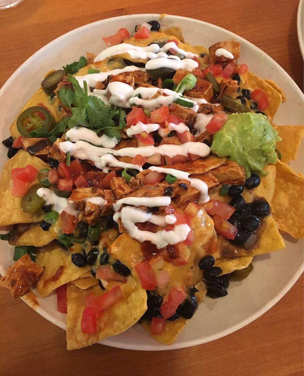 """Photo of Veggie Grill - University Center  by <a href=""""/members/profile/buzzthepug"""">buzzthepug</a> <br/>They do such an interesting and great take on vegan nachos!  <br/> March 22, 2018  - <a href='/contact/abuse/image/9434/374570'>Report</a>"""