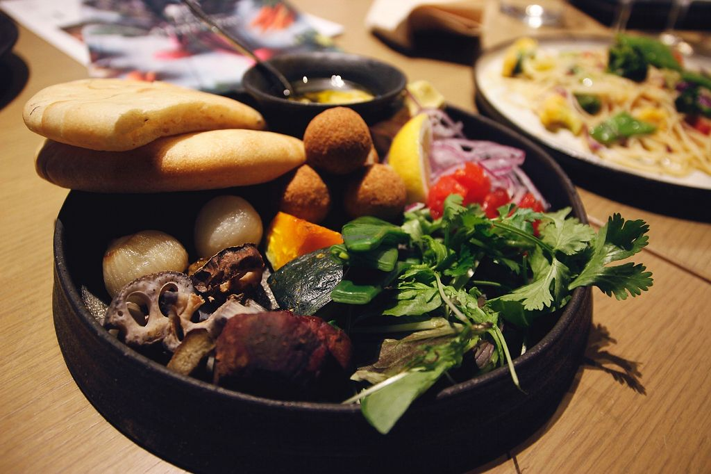 """Photo of Cosme Kitchen Adaptation - Omotesando Hills  by <a href=""""/members/profile/YukiLim"""">YukiLim</a> <br/>Vegan falafel plate with pita and veggies <br/> July 17, 2017  - <a href='/contact/abuse/image/94441/281451'>Report</a>"""