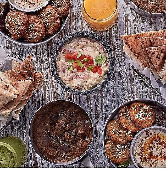 """Photo of Eatery  by <a href=""""/members/profile/Yasminenazmy"""">Yasminenazmy</a> <br/>A typical Egyptian meal -fool, ta'meya, hummus <br/> July 2, 2017  - <a href='/contact/abuse/image/94514/275956'>Report</a>"""