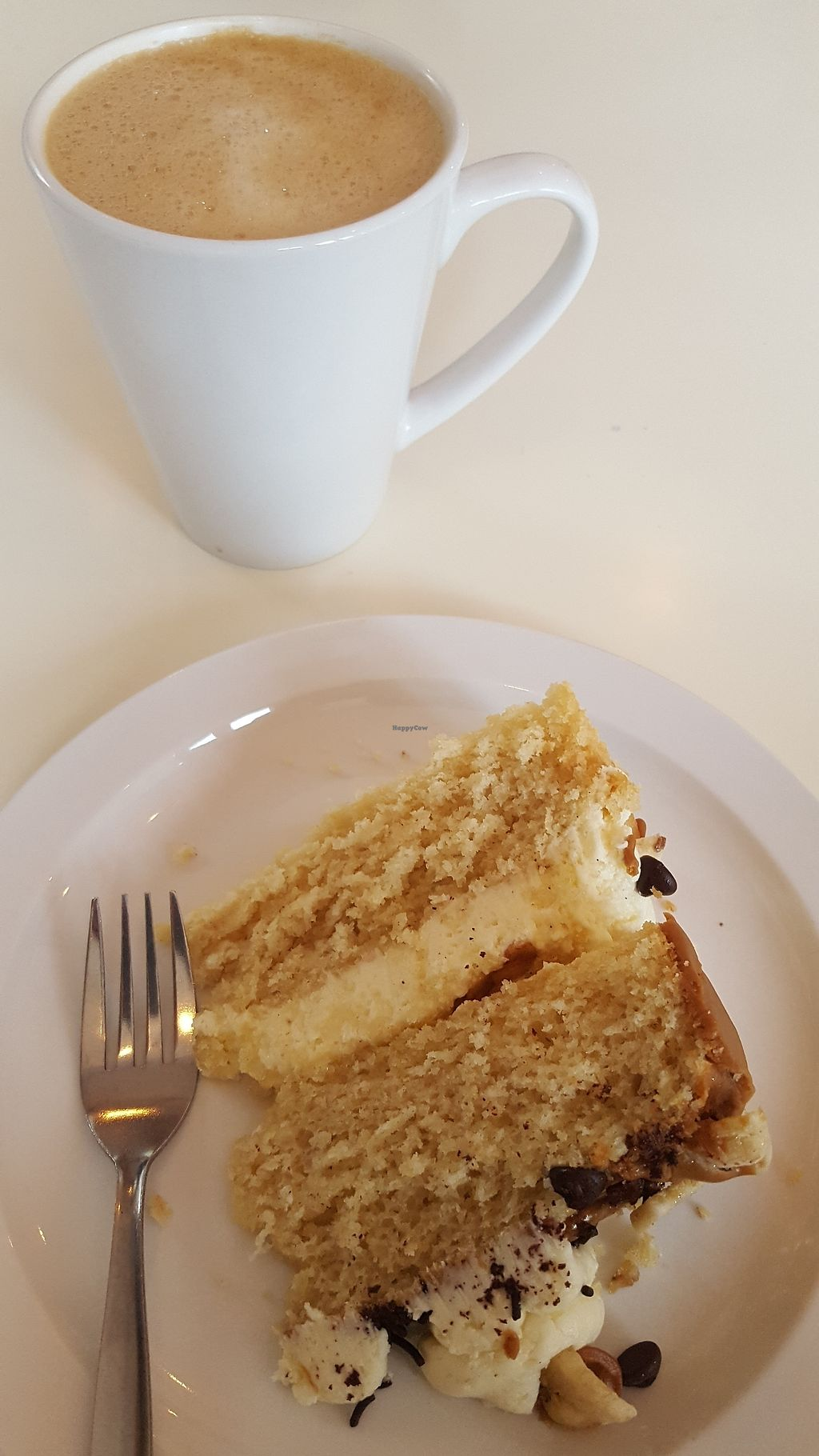 """Photo of The Kind Grind  by <a href=""""/members/profile/VeganAnnaS"""">VeganAnnaS</a> <br/>Banoffee cake and oat latte <br/> January 4, 2018  - <a href='/contact/abuse/image/95003/343023'>Report</a>"""