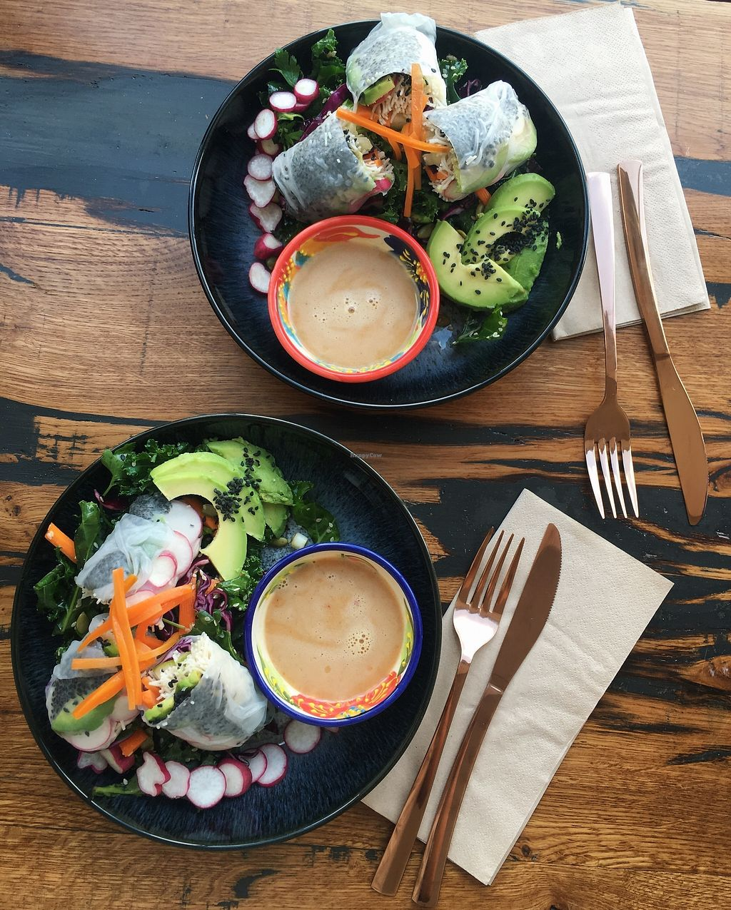 """Photo of Lone Wolves Organics  by <a href=""""/members/profile/loisgb"""">loisgb</a> <br/>The Slaw Salad - an Asian inspired slaw of red cabbage, kale, carrot, spring onion, sesame seeds and pumpkin seeds with a tamari, lime, ginger and chilli dressing. Served with Summer Rolls (rice paper rolls filled with brown rice noodles, black sesame seeds, carrots, avocado, radish and cucumber), avocado, crunchy radishes and sweet pickled carrots, with a peanut dipping sauce <br/> July 5, 2017  - <a href='/contact/abuse/image/95415/276960'>Report</a>"""