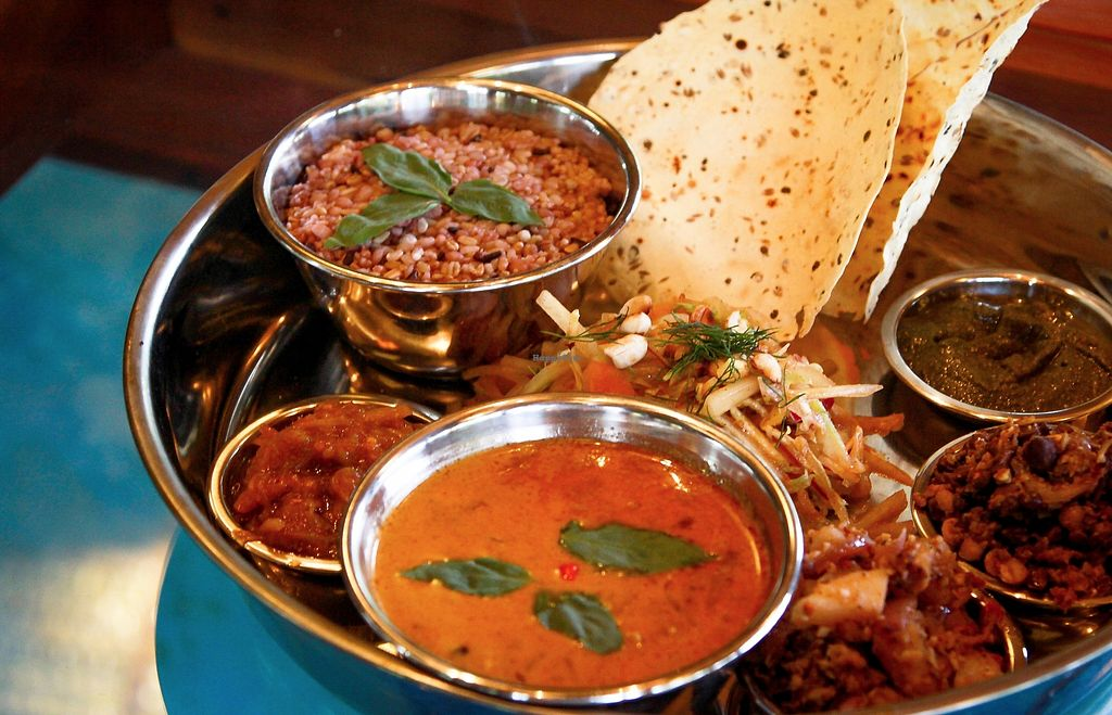 """Photo of Lotus Shores  by <a href=""""/members/profile/LouiseIsobel"""">LouiseIsobel</a> <br/>Our North Indian Thali featuring a Chana Malasa (Chickpea Curry), poppadom and more  <br/> July 6, 2017  - <a href='/contact/abuse/image/95531/277286'>Report</a>"""