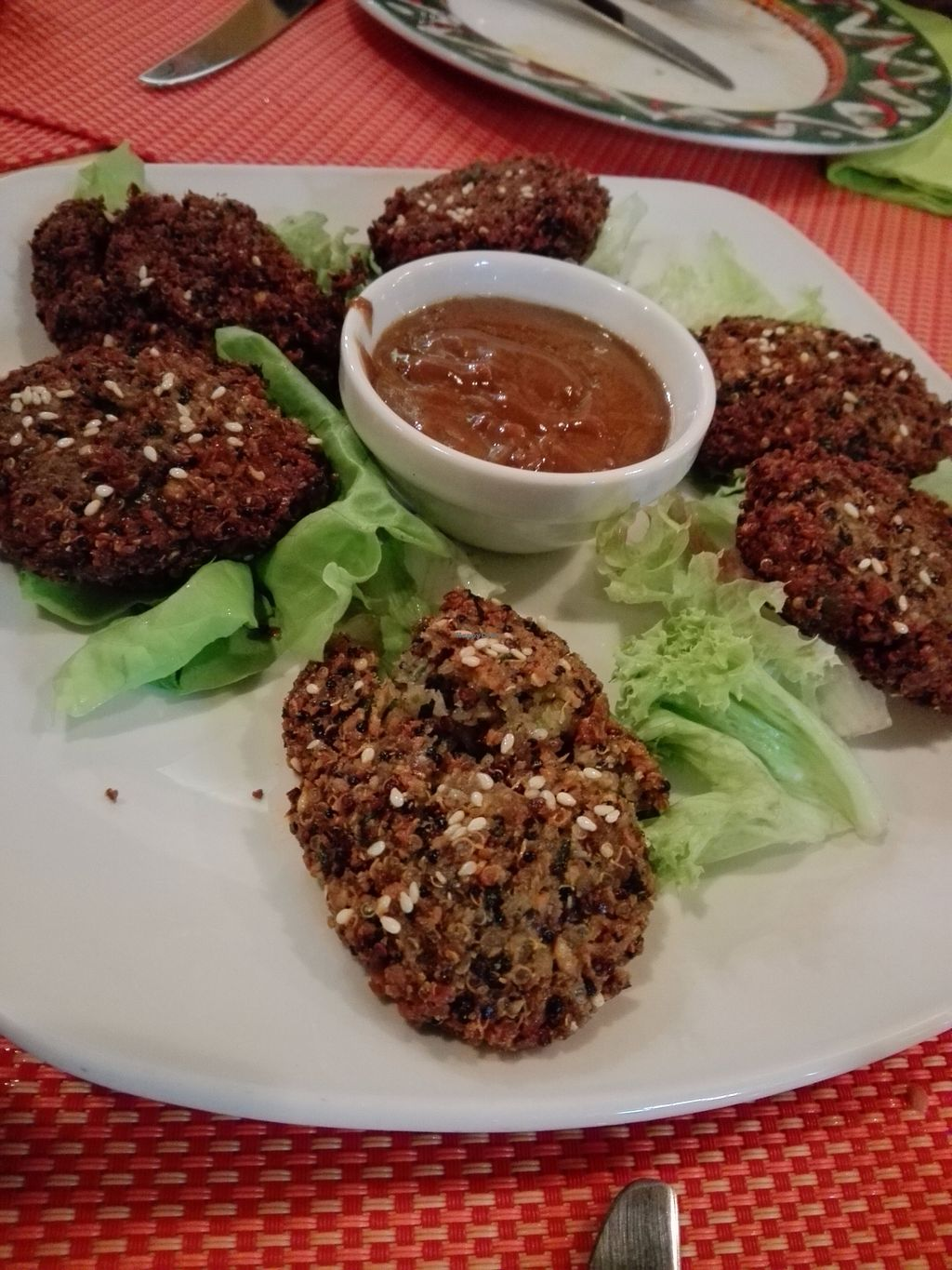 """Photo of Aztec  by <a href=""""/members/profile/ElisaGR"""">ElisaGR</a> <br/>Balls of quinoa, sesame, flax seed and beans with sauce from coconut milk and peanut butter <br/> October 31, 2017  - <a href='/contact/abuse/image/95599/320571'>Report</a>"""