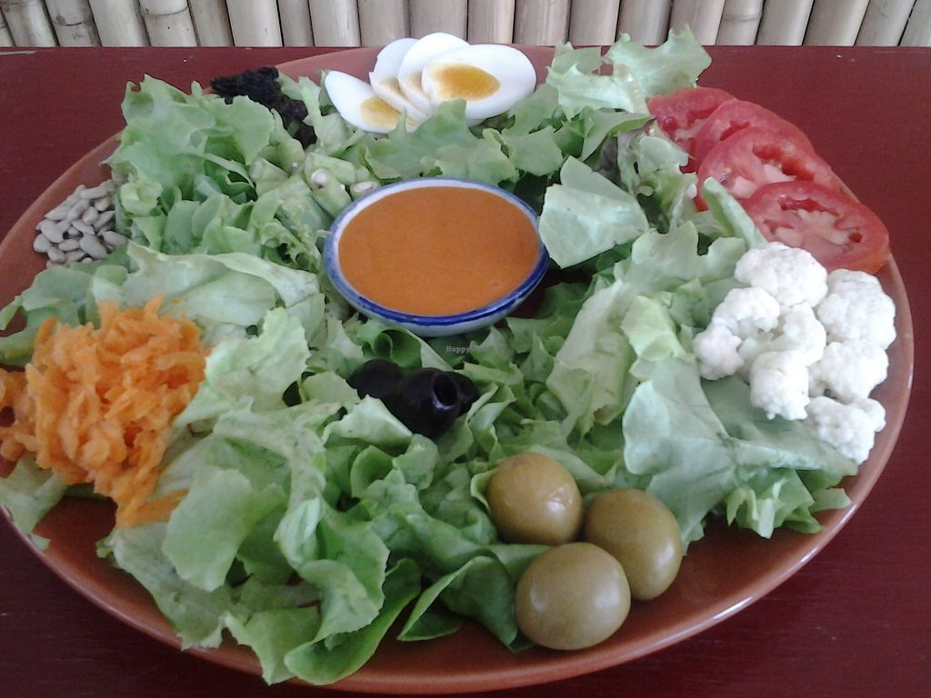 """Photo of Rawkin Cafe  by <a href=""""/members/profile/getjuicedforlife"""">getjuicedforlife</a> <br/>Our succulent salad! Mixed greens, carrot, tomato, cauliflower, raisins, olives egg (optional), sweet dressing <br/> September 30, 2017  - <a href='/contact/abuse/image/95624/309983'>Report</a>"""