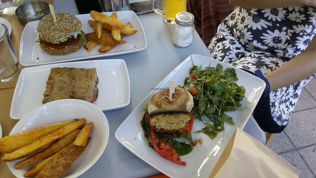 """Photo of Kardamon  by <a href=""""/members/profile/MariannaGiannakopoul"""">MariannaGiannakopoul</a> <br/>Vegetable burger with porto bello mushrooms & salad, Veggie mushroom burger & fried potatoes, Mousaka vegan, Fried potatoes with garlic and herb flavor <br/> September 20, 2017  - <a href='/contact/abuse/image/95927/306354'>Report</a>"""