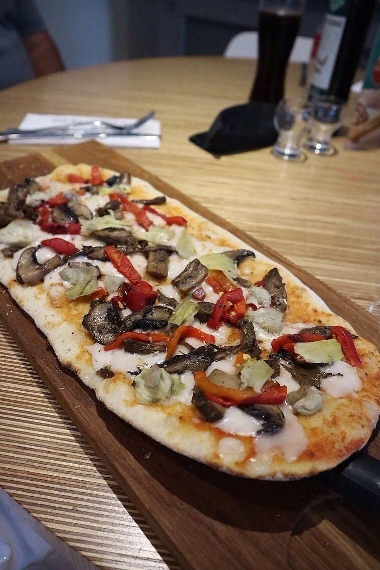 "Photo of Ask Italian  by <a href=""/members/profile/charclothier"">charclothier</a> <br/>This was a vegan pizza with vegan cheese roasted peppers artichokes and mushrooms it was so amazing I couldn't believe it <br/> July 13, 2017  - <a href='/contact/abuse/image/96087/280000'>Report</a>"
