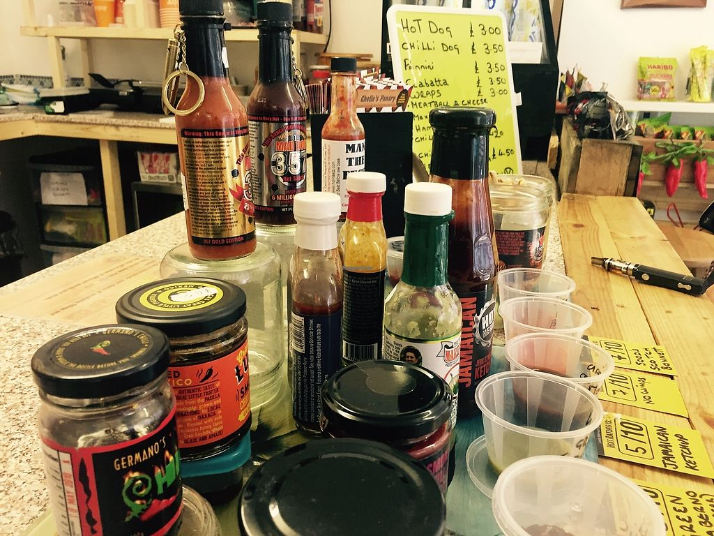 """Photo of Chelle's Pantry  by <a href=""""/members/profile/TARAMCDONALD"""">TARAMCDONALD</a> <br/>Lots of vegan spicy sauce options <br/> August 19, 2017  - <a href='/contact/abuse/image/96288/294362'>Report</a>"""