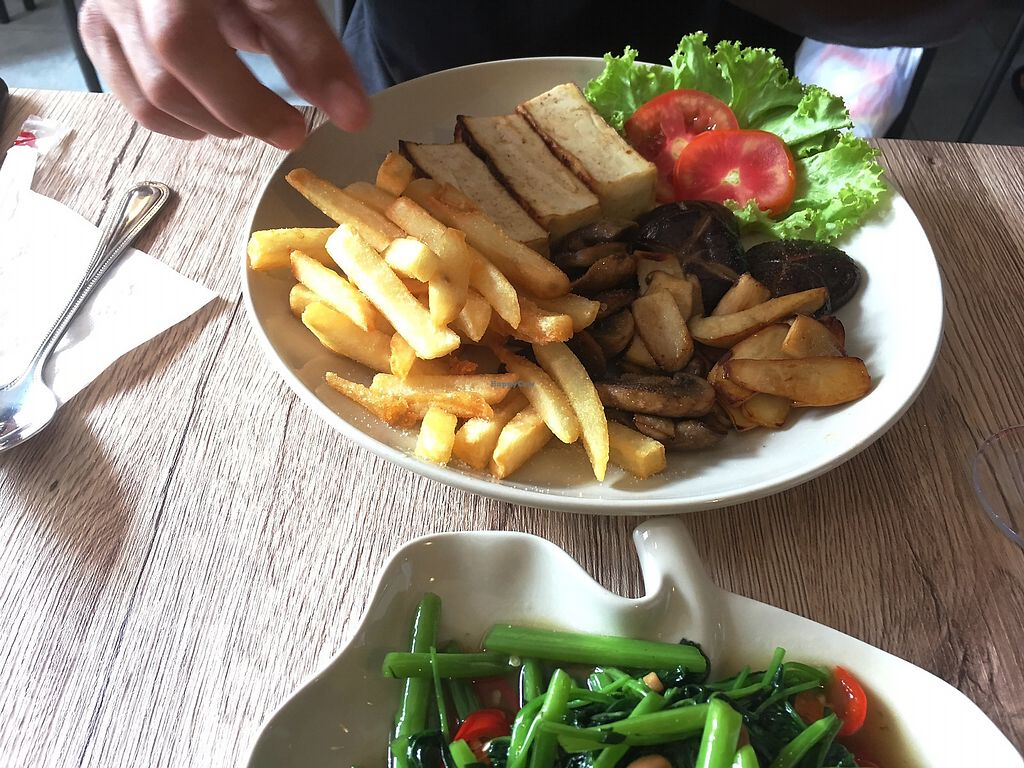"""Photo of Dow Vegetarian Restaurant  by <a href=""""/members/profile/evaPhiPhi"""">evaPhiPhi</a> <br/>Tofu Steak with Mushrooms and Chips <br/> August 2, 2017  - <a href='/contact/abuse/image/96395/287888'>Report</a>"""