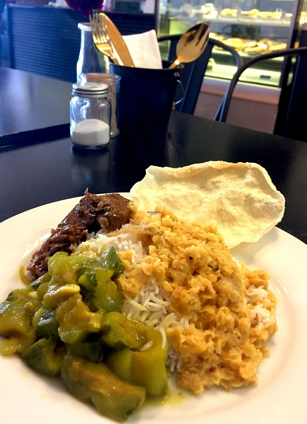 "Photo of Cafe Dinicious  by <a href=""/members/profile/karlaess"">karlaess</a> <br/>Assorted vegan curries with rice <br/> August 12, 2017  - <a href='/contact/abuse/image/96603/291887'>Report</a>"