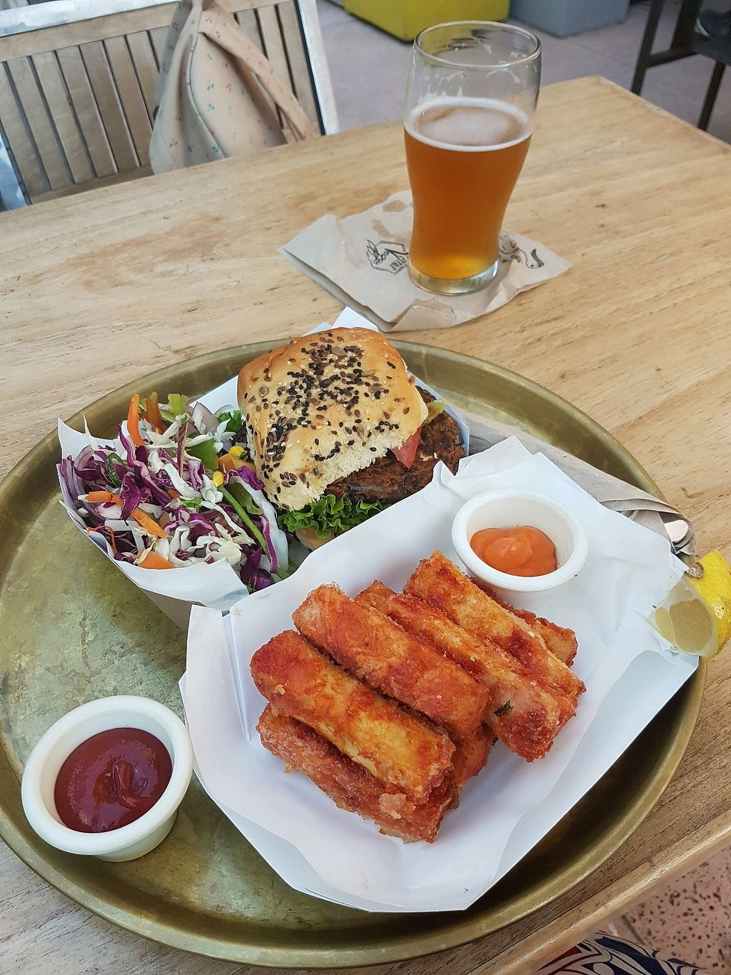 """Photo of Estilo Veggie  by <a href=""""/members/profile/Olena"""">Olena</a> <br/>tofu wings and burger  <br/> April 12, 2018  - <a href='/contact/abuse/image/96764/384664'>Report</a>"""