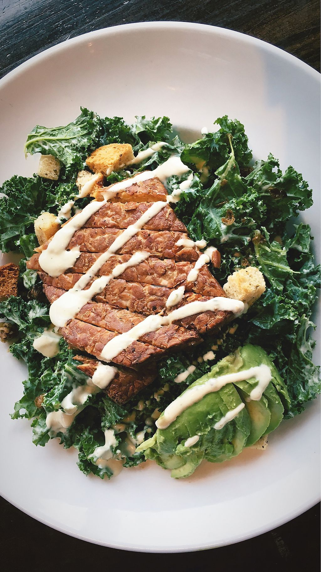 """Photo of Garibaldi Lift Co Bar & Grill  by <a href=""""/members/profile/clovely.vegan"""">clovely.vegan</a> <br/>Grilled Tempeh Kale Caesar Salad <br/> February 23, 2018  - <a href='/contact/abuse/image/96793/362755'>Report</a>"""