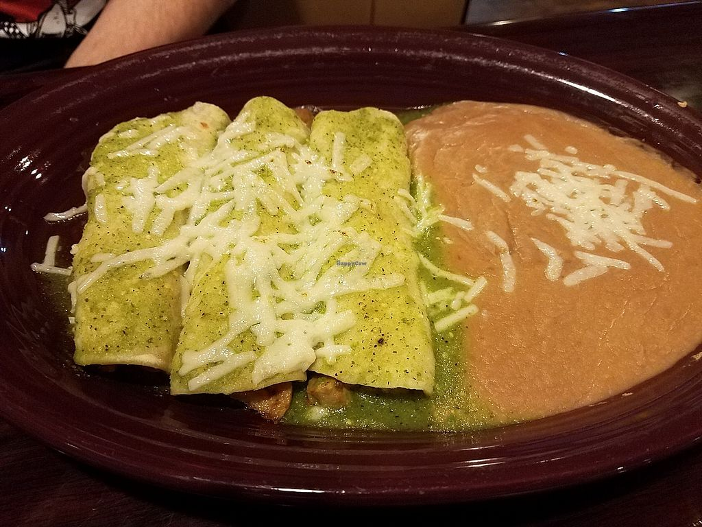 "Photo of Don Emiliano's Restaurante Mexicano  by <a href=""/members/profile/fondducoeur"">fondducoeur</a> <br/>Vegan enchiladas with seitan and refried beans <br/> March 28, 2018  - <a href='/contact/abuse/image/97060/377486'>Report</a>"
