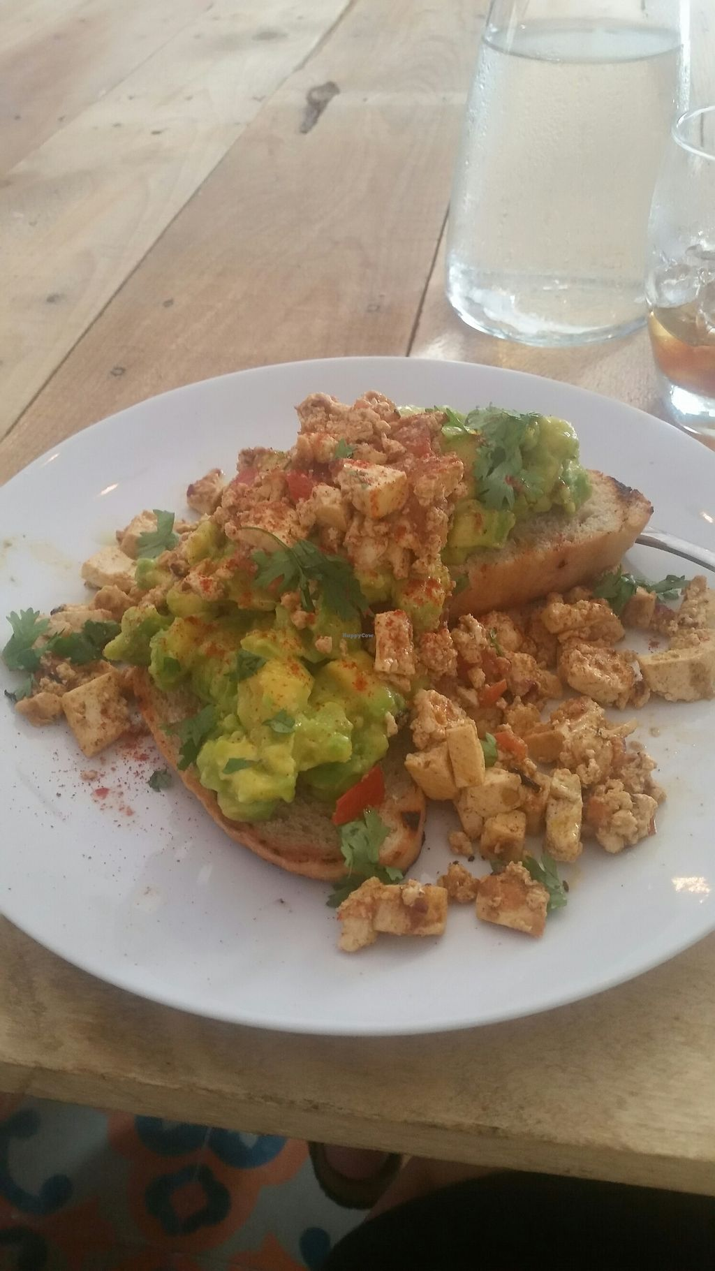 "Photo of Cafe Stepping Stone  by <a href=""/members/profile/LauraCatattack"">LauraCatattack</a> <br/>mashed avocado with tofu on toast <br/> July 29, 2017  - <a href='/contact/abuse/image/97416/286377'>Report</a>"