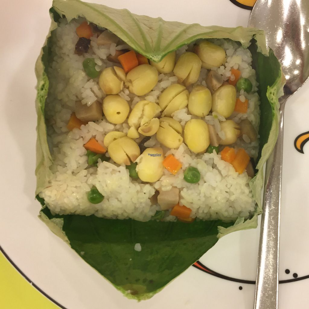 """Photo of Loving Hut Hoa Dang  by <a href=""""/members/profile/ghostgumtrees"""">ghostgumtrees</a> <br/>Steamed rice with lotus seeds and vegetables wrapped in lotus leaf <br/> March 22, 2017  - <a href='/contact/abuse/image/9742/239382'>Report</a>"""