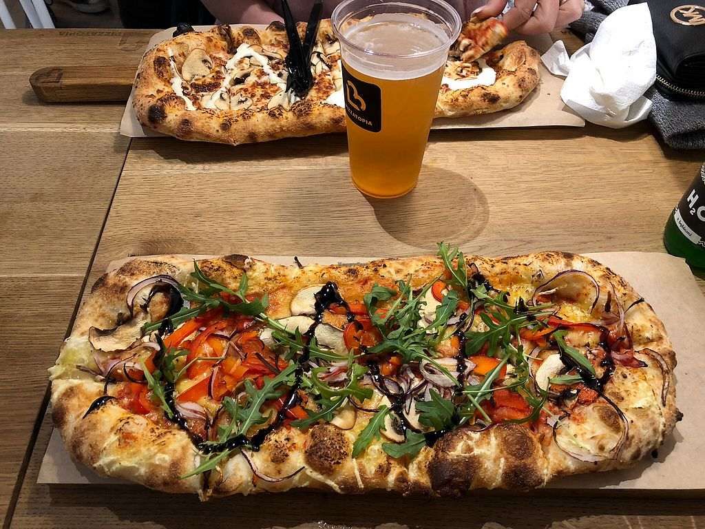 """Photo of Pizzatopia  by <a href=""""/members/profile/Sophiapalmqvist"""">Sophiapalmqvist</a> <br/>Best vegan pizza!! (The pizza in the background is not vegan) <br/> January 21, 2018  - <a href='/contact/abuse/image/97708/349308'>Report</a>"""
