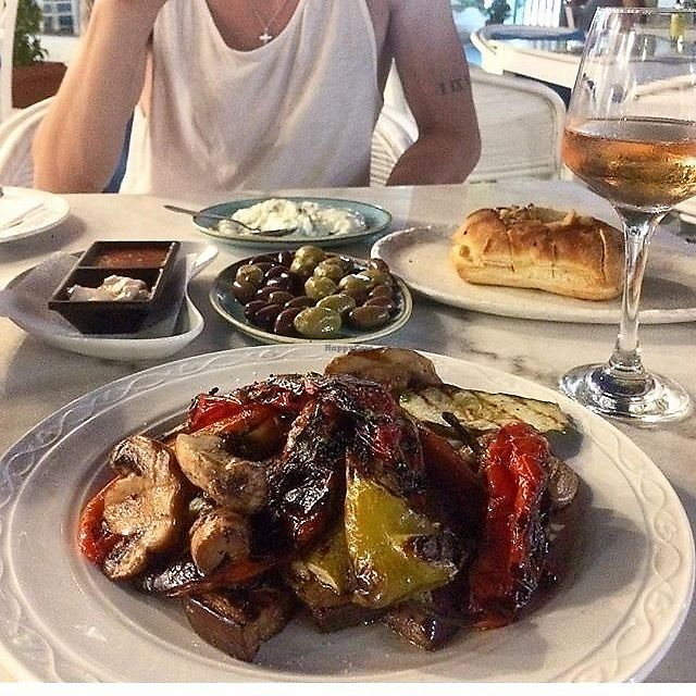 "Photo of Caldera Taverna Bar  by <a href=""/members/profile/audmarlen"">audmarlen</a> <br/>Grilled veggies with balsamic, mayo dip, tomato dip, tzatziki, olives, garlic bread with olive oil.  <br/> August 4, 2017  - <a href='/contact/abuse/image/97846/288791'>Report</a>"