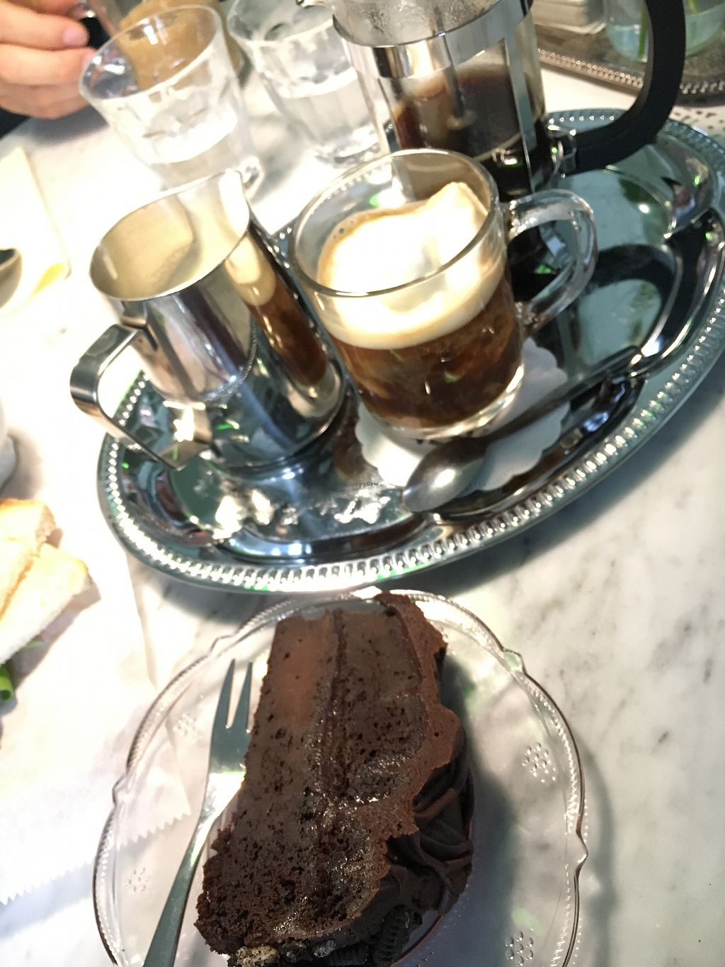 "Photo of Julia & Julia  by <a href=""/members/profile/turtleveg"">turtleveg</a> <br/>vegan chocolate cake with French press coffee and steamed soy milk  <br/> August 8, 2017  - <a href='/contact/abuse/image/97880/290431'>Report</a>"