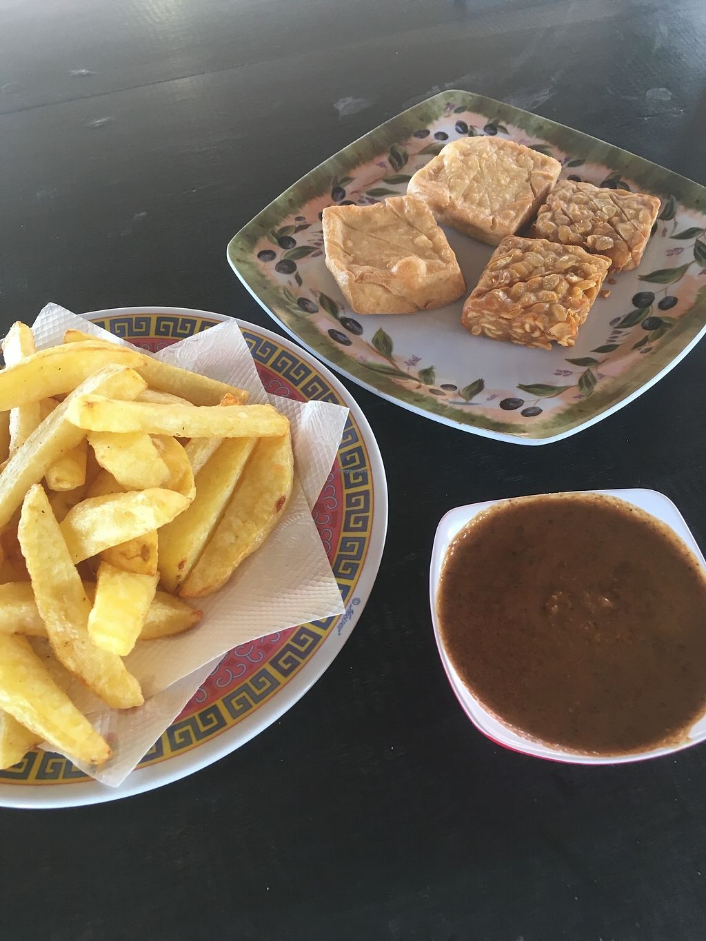 """Photo of Ryan's Cafe  by <a href=""""/members/profile/jojoinbrighton"""">jojoinbrighton</a> <br/>Tempeh, peanut sauce, french fries <br/> August 5, 2017  - <a href='/contact/abuse/image/97916/289453'>Report</a>"""