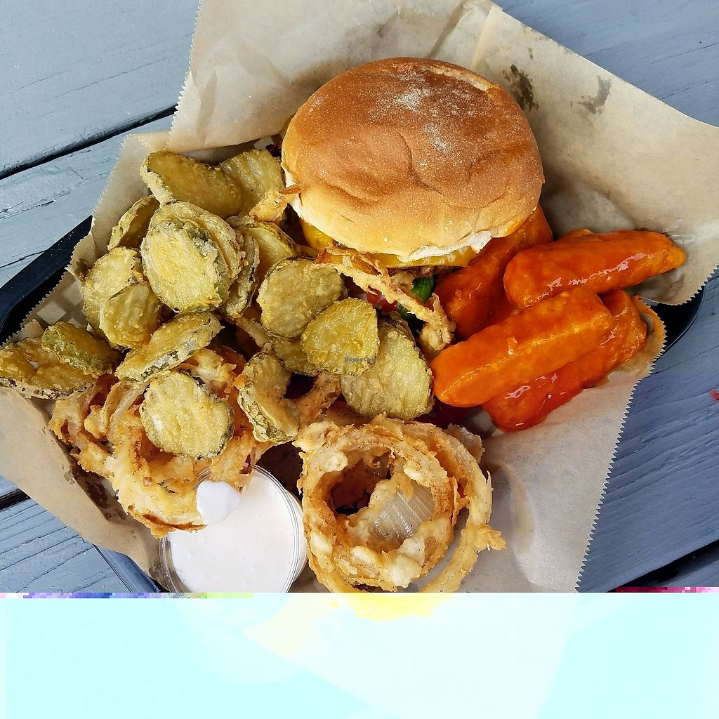 "Photo of Eden Burger  by <a href=""/members/profile/Silly%20Little%20Vegan"">Silly Little Vegan</a> <br/>Burger, onion rings, pickle chips, and buffalo tempeh tenders <br/> September 25, 2017  - <a href='/contact/abuse/image/97977/308032'>Report</a>"
