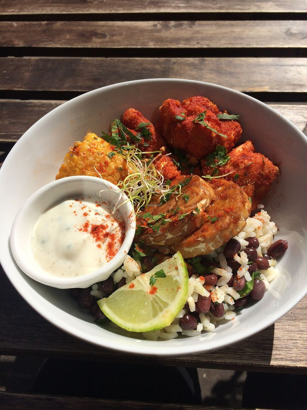 """Photo of Comptoir Veggie  by <a href=""""/members/profile/sabrinajh"""">sabrinajh</a> <br/>Buddha bowl - bbq cauliflower, tempeh, rice with black beans, corn on the cob with a creamy white sauce (tasted kind of like sour cream or tziki).  <br/> April 13, 2018  - <a href='/contact/abuse/image/98252/385253'>Report</a>"""