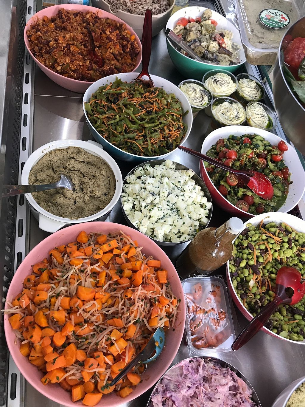 """Photo of Dollys2go  by <a href=""""/members/profile/Greedygutsgirl"""">Greedygutsgirl</a> <br/>Choose your ingredients for toasted wraps from the colorful salads. Enjoy hot falafels with different types of houmous. There are also gluten free options for all sandwiches and buckwheat blinis <br/> August 11, 2017  - <a href='/contact/abuse/image/98354/291645'>Report</a>"""