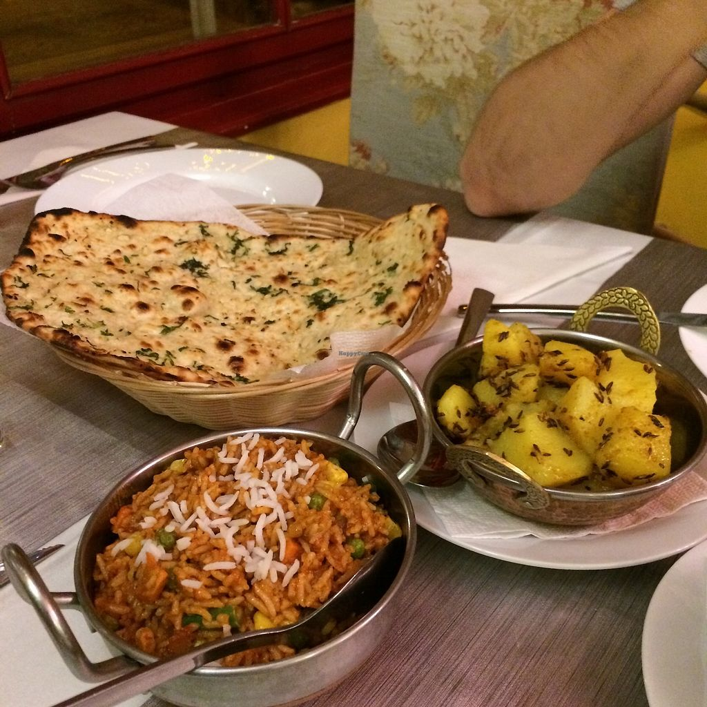 """Photo of Restaurant India  by <a href=""""/members/profile/becx.ray"""">becx.ray</a> <br/>Garlic naan, briyani and potato <br/> August 24, 2017  - <a href='/contact/abuse/image/98456/296812'>Report</a>"""