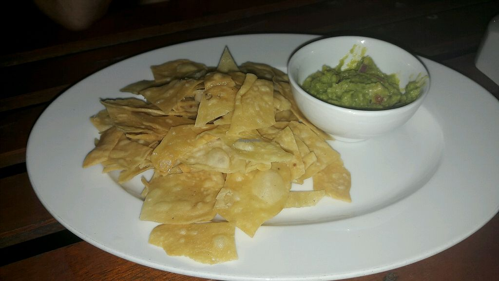 """Photo of Easy Tiger Hostel - Jungle Bar  by <a href=""""/members/profile/Bintje"""">Bintje</a> <br/>chips homemade and guacamole  <br/> May 17, 2018  - <a href='/contact/abuse/image/98462/401004'>Report</a>"""