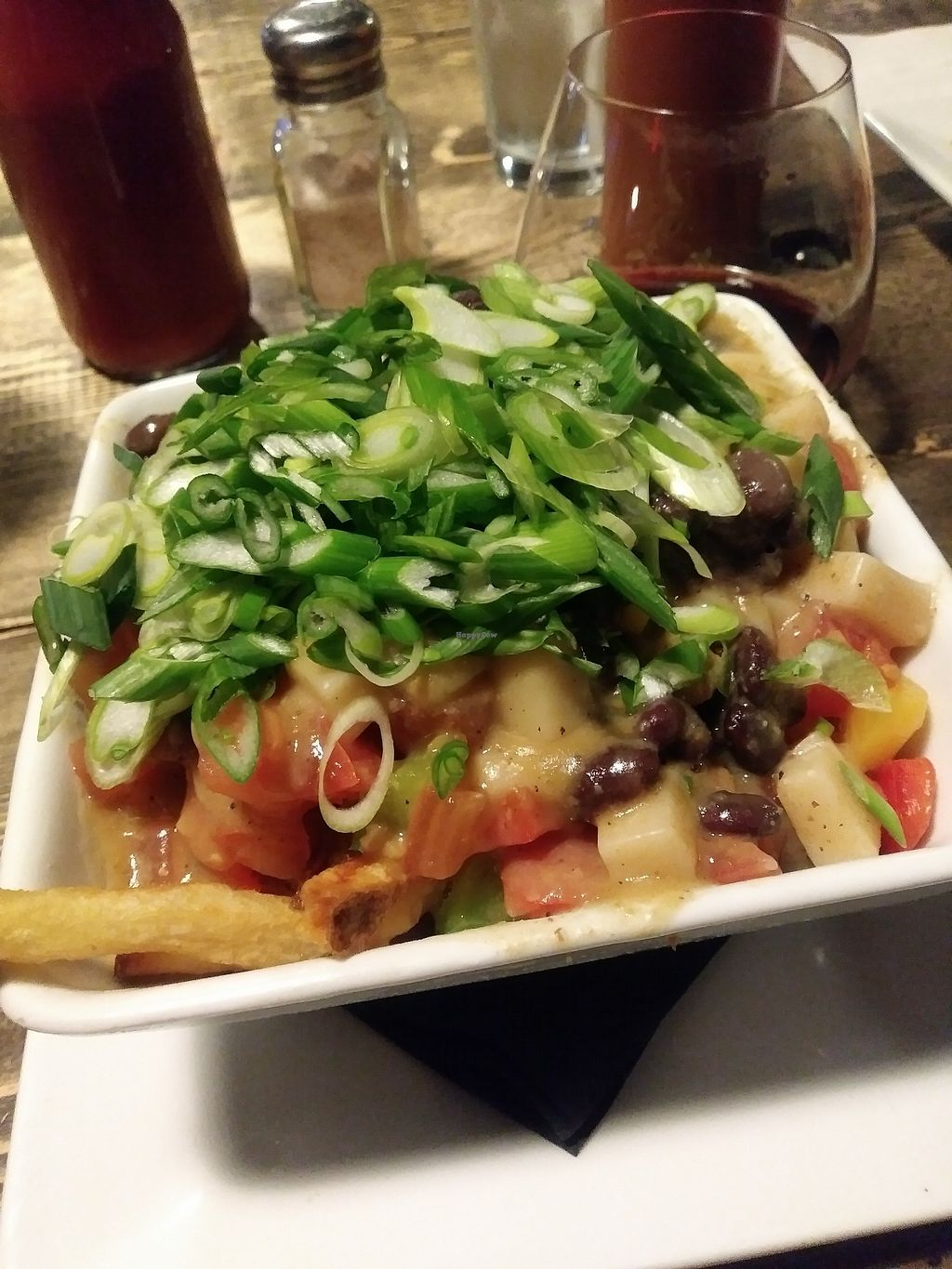 """Photo of Small Axe Bistro  by <a href=""""/members/profile/LolaMeow"""">LolaMeow</a> <br/>Vegan Nacho Poutine <br/> February 15, 2018  - <a href='/contact/abuse/image/98968/359701'>Report</a>"""