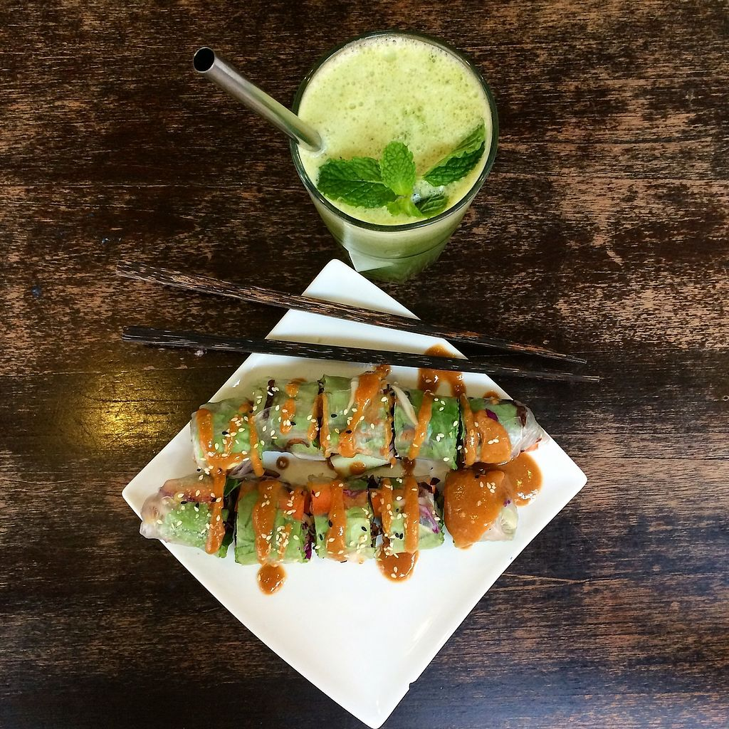 """Photo of Big Bite Home Style Veggie Cafe  by <a href=""""/members/profile/M%C3%A9linaBrard"""">MélinaBrard</a> <br/>Green juice and Vietnamese rolls <br/> January 21, 2018  - <a href='/contact/abuse/image/99055/349301'>Report</a>"""