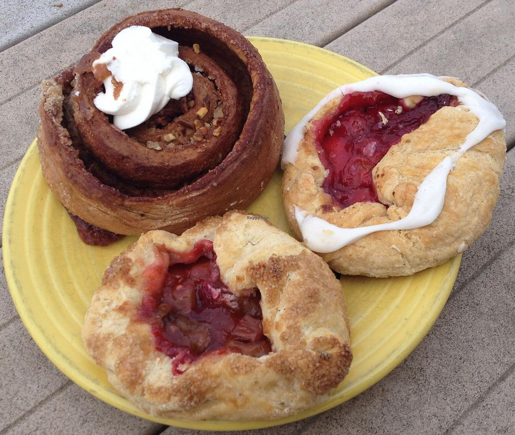 Photo of East Side Ovens Bakery  by RamblingVegans <br/>Cherry dumpling, raspberry rhubarb dumpling and pecan cinnamon roll.   <br/> March 15, 2014  - <a href='/contact/abuse/image/9914/65958'>Report</a>