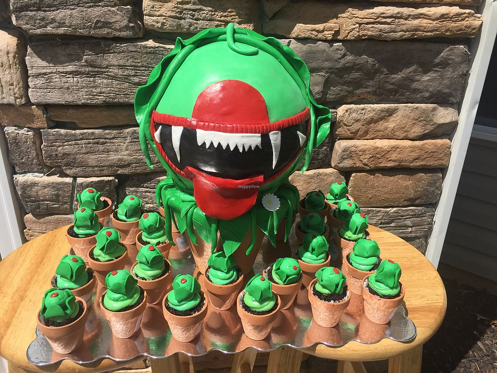"""Photo of Free Birds Vegan Bakery  by <a href=""""/members/profile/freebirdsvb"""">freebirdsvb</a> <br/>""""Killer Plants"""" cake from Little Shop of Horrors <br/> August 22, 2017  - <a href='/contact/abuse/image/99239/295448'>Report</a>"""